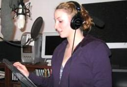 Sarah Block recording an animated script in the Allport Productions VoiceOver Booth